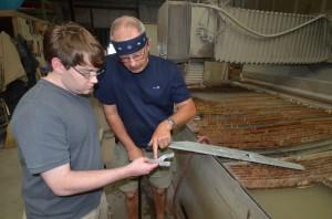 Slingshot cut from aluminum using an abrasive waterjet process.