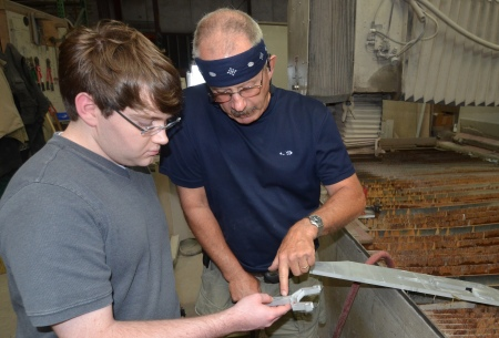 Al Ely (ADR Hydrocut) teaching Nick the finer points of designing for waterjet cutting